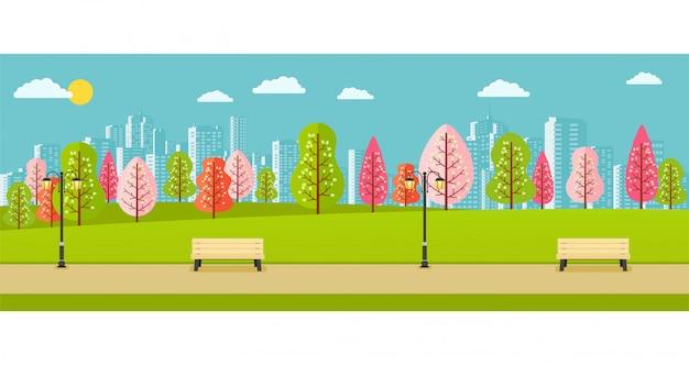 Parc public de printemps avec des arbres roses, rouges et verts et une vue sur la ville.