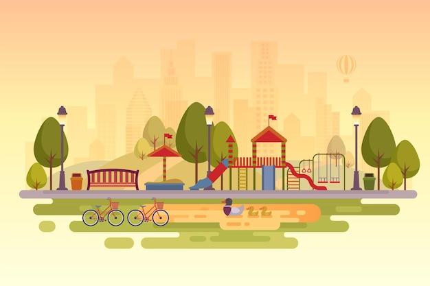 Parc de la ville avec aire de jeux fond de coucher de soleil