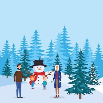 Parents couple avec enfants et bonhomme de neige dans le paysage de neige