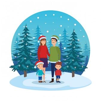 Parents couple avec enfants et vêtements d'hiver dans le paysage de neige