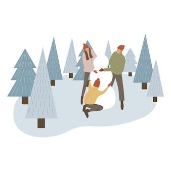 Parents et enfants faisant bonhomme de neige ensemble