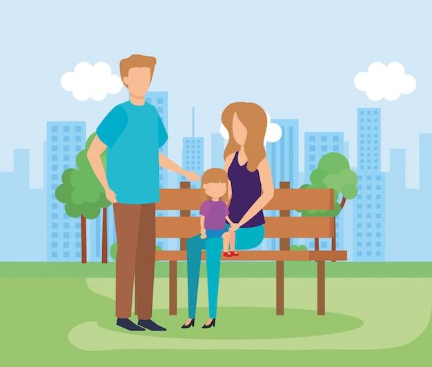Parents avec fille dans le parc