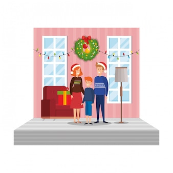 Parents avec fils dans le salon avec décoration de noël