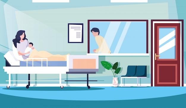 Parents avec nouveau-né en salle d'hospitalisation sur civière