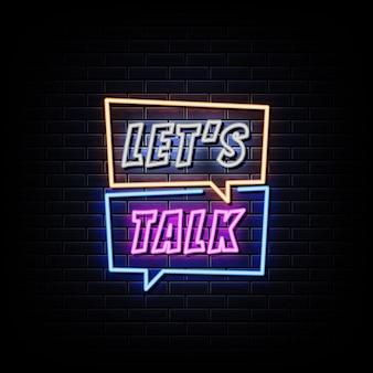 Parlons enseigne au néon sur le mur noir
