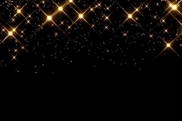 Particules incandescentes sur fond noir.