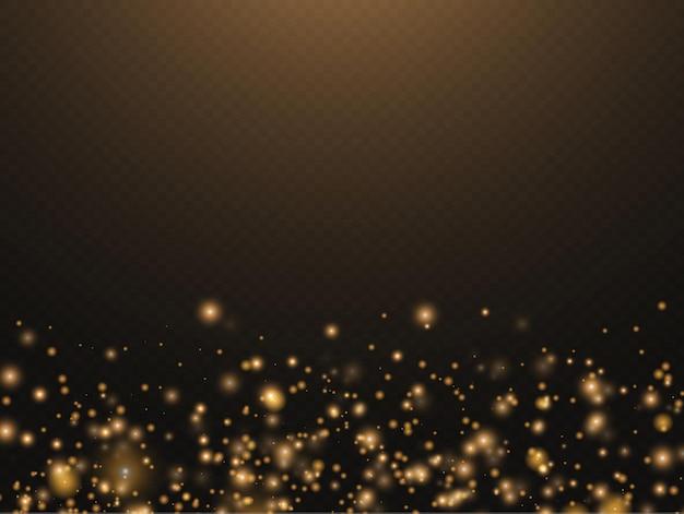 Des particules de poussière magique dorées scintillantes scintillent des lumières brillantes, des étincelles de poussière jaunes et des étoiles