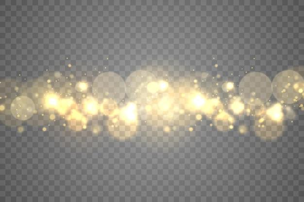 Particules de poussière magique étincelante sur fond transparent.