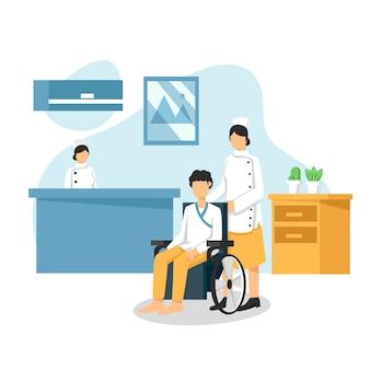 Patient en fauteuil roulant assis dans le couloir de l'hôpital avec une infirmière