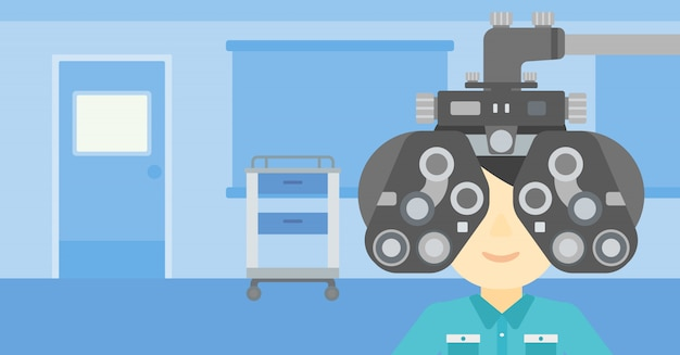Patient pendant l'examen de la vue