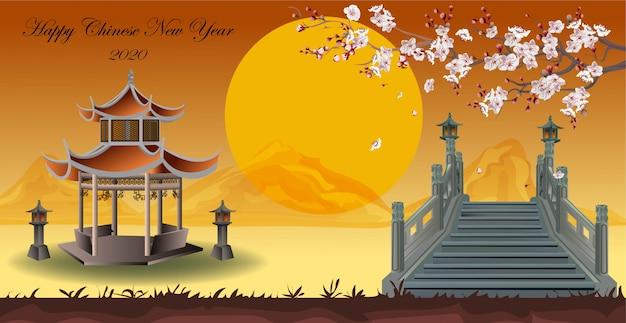Pavillon de relaxation chinois dans le jardin avec de beaux pruniers s'étendant sur le pont en montagne