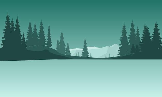Paysage avec des arbres de silhouettes et des montagnes