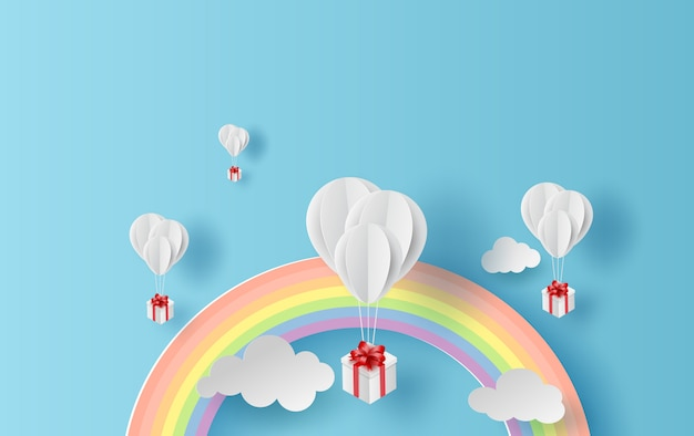 Paysage d'arc-en-ciel et ballons sur ciel