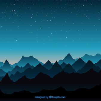 Paysage bleu avec des montagnes