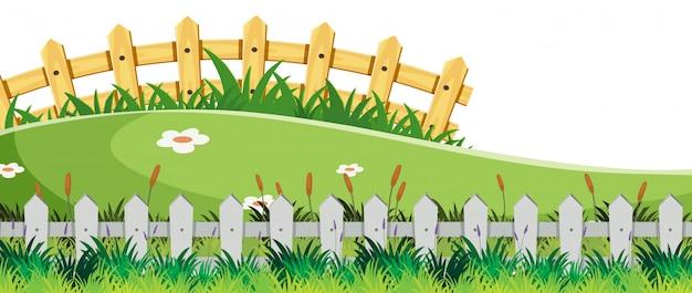 Paysage avec des clôtures et de l'herbe