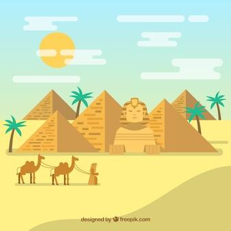 Paysage du désert égyptien avec des pyramides et des caravanes