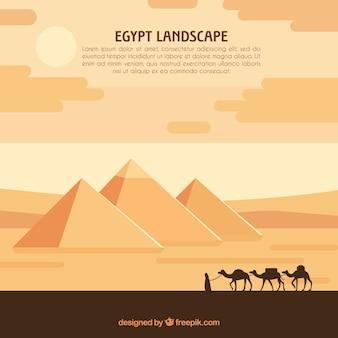 Paysage d'egypte avec caravane et pyramides