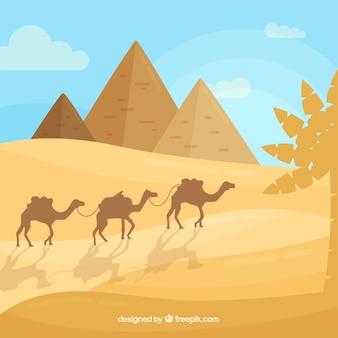 Paysage d'egypte avec des pyramides et des caravanes