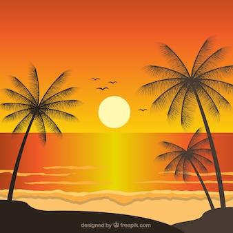 Paysage fantastique avec des palmiers au coucher du soleil