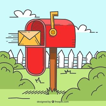 Paysage de fond avec une boîte aux lettres rouge