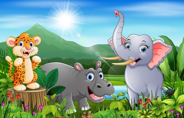 Paysage forestier avec dessin animé joyeux animaux