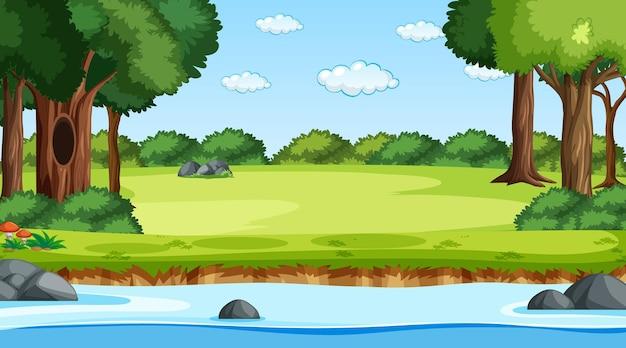 Paysage forestier naturel sur scène diurne avec rivière qui traverse la forêt