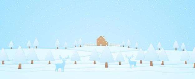 Paysage d'hiver, maison et arbres sur la colline avec rennes, chute de neige, style art papier