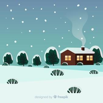 Paysage d'hiver de la maison couverte de neige