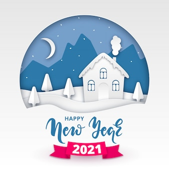 Paysage d'hiver style papier découpé avec maison couverte de neige, arbres et lettrage avec ruban. joyeux noël et bonne année 2021 illustration pour le web, design, impression, carte de voeux