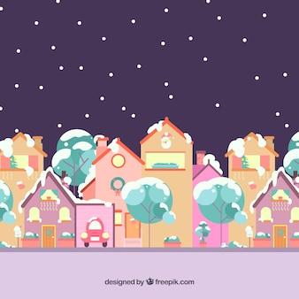Paysage d'hiver avec une ville colorée
