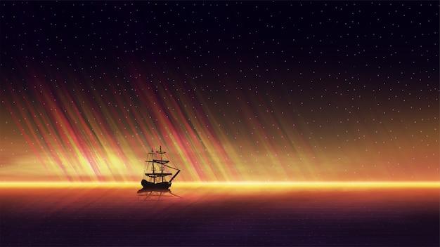 Paysage marin du soir avec un beau coucher de soleil orange sur l'horizon de la mer, ciel étoilé et un navire à l'horizon