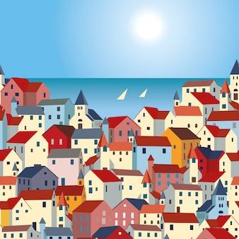 Paysage avec mer, maisons colorées et yachts.