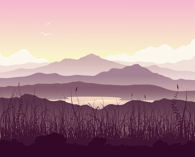 Paysage de montagne avec herbe et immense lac