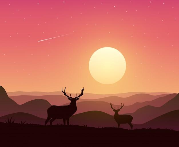 Paysage de montagnes avec deux cerfs au coucher du soleil