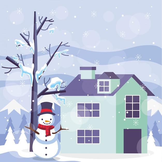 Paysage de montagnes d'hiver bleu avec bonhomme de neige et maison