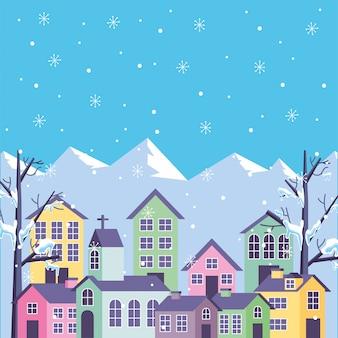 Paysage de montagnes d'hiver bleu avec des maisons
