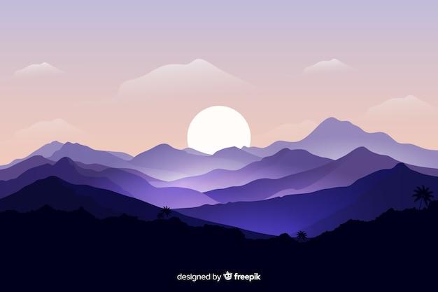 Paysage de montagnes avec le lever du soleil