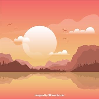Paysage montagneux fond au coucher du soleil