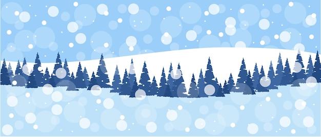 Paysage naturel d'hiver champ avec des sapins enneigés des collines blanches congères ciel avec des flocons de neige