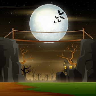 Paysage de nuit d'halloween avec pont sur la falaise