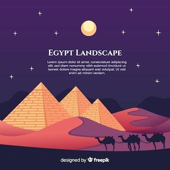 Paysage de nuit plate avec des pyramides égyptiennes et la caravane de chameaux