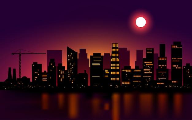 Paysage de nuit de la ville avec la pleine lune