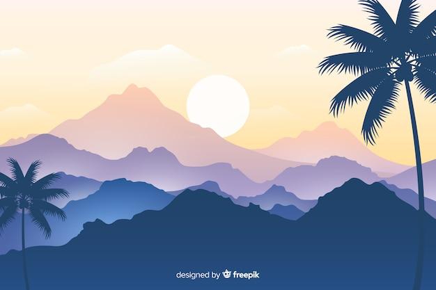 Paysage de palmiers et de chaînes de montagnes