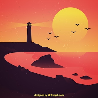 Paysage de plage avec phare au coucher du soleil