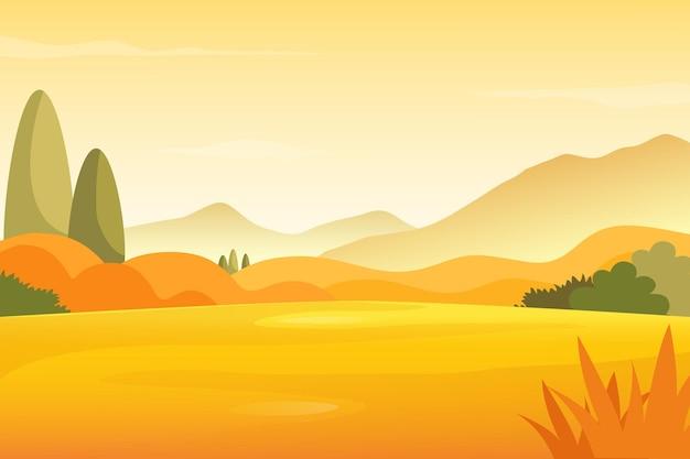 Paysage de prairie d'automne avec fond de montagnes.
