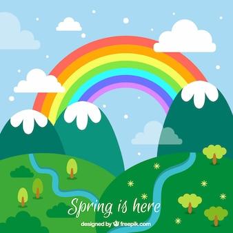 Paysage de printemps avec arc-en-ciel