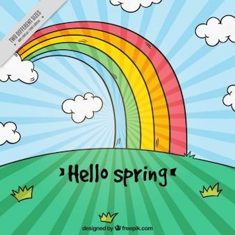 Paysage de printemps de fond avec arc en ciel