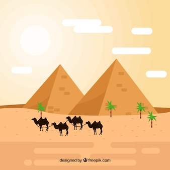 Paysage de pyramide avec caravane