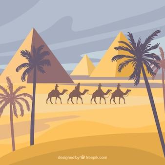 Paysage de pyramides égyptiennes avec la caravane de chameaux