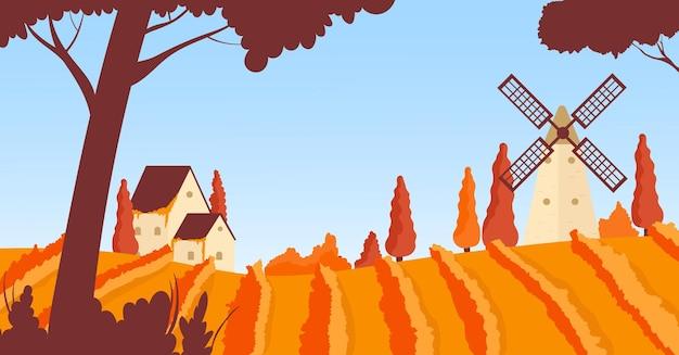 Paysage rural d'automne de vignoble avec le moulin orange de collines d'agriculture scénique de maison de ferme